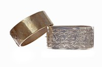 Lot 20-TWO NINETEENTH CENTURY BANGLES one continental...