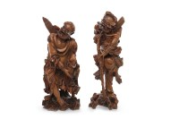 Lot 1026-TWO 20TH CENTURY CHINESE CARVED WOODEN FIGURES OF ...