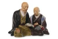 Lot 1076 - MID 20TH CENTURY JAPANESE CERAMIC FIGURE GROUP...