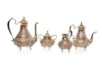 Lot 1087 - PERSIAN WHITE METAL FOUR PIECE TEA SERVICE...