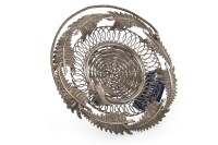Lot 1089 - EASTERN WHITE METAL BASKET formed with a...
