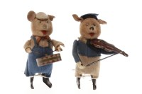 Lot 1620-TWO SCHUCO CLOCKWORK MUSICAL PIGS with felt...