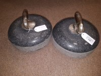 Lot 1648-PAIR OF GRANITE CURLING STONES with turned wood...