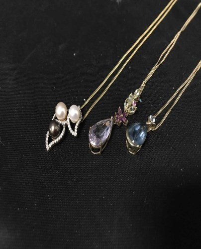 Lot 15-THREE 9CT GOLD PENDANTS AND CHAINS with pearl and ...