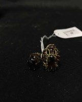 Lot 50-TWO NINE CARAT GOLD AND GARNET DRESS RINGS