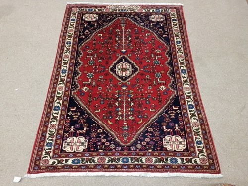 Lot 1065-THREE 20TH CENTURY EASTERN BORDERED RUGS one with ...