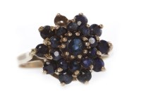 Lot 637-NINE CARAT GOLD GEM SET CLUSTER RING the tiered...