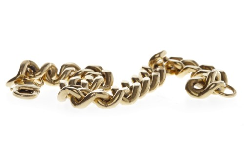 Lot 644 - GENTLEMAN'S NINE CARAT GOLD BRACELET formed by...