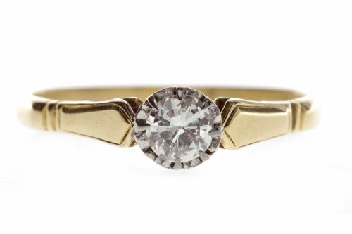 Lot 653-DIAMOND SOLITAIRE RING with an illusion set round ...