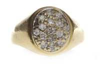 Lot 678-EIGHTEEN CARAT GOLD DIAMOND SIGNET RING with an...