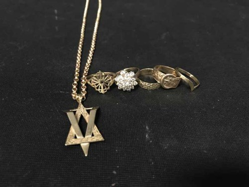 Lot 14-FIVE GOLD RINGS also a Star of David pendant with ...