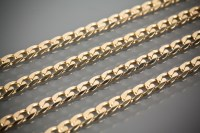 Lot 1212 - THREE NINE CARAT GOLD NECKLACES AND A NINE...