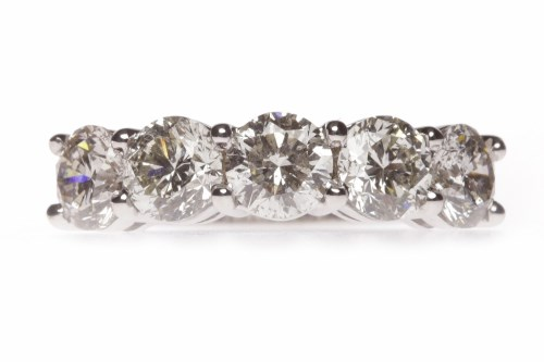 Lot 16 - IMPRESSIVE DIAMOND FIVE STONE RING with round...