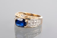 Lot 1212 - SAPPHIRE AND DIAMOND DRESS RING the oval...