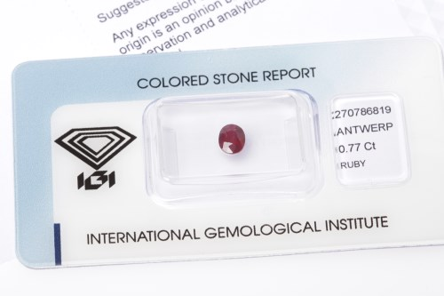 Lot 71-CERTIFICATED UNMOUNTED RUBY the oval stone of...
