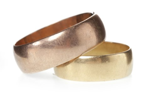 Lot 501-TWO GOLD WEDDING BANDS comprising a gentleman's...