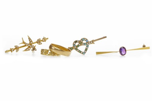 Lot 505-FIFTEEN CARAT GOLD SWALLOW MOTIF BROOCH set with...