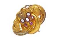 Lot 507-VICTORIAN GEM SET BROOCH formed by looping...