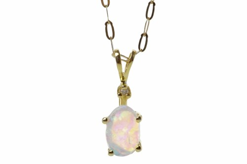 Lot 514-TEN CARAT GOLD OPAL AND DIAMOND PENDANT the opal...