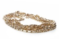 Lot 519-GOLD CHAIN NECKLACE formed by three strands of...