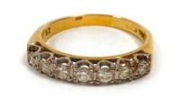 Lot 534-DIAMOND SEVEN STONE RING set with round brilliant ...