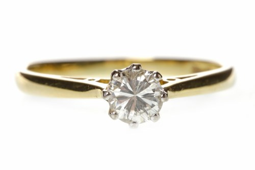 Lot 535-DIAMOND SOLITAIRE RING with an eight claw set...