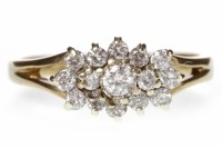 Lot 578-NINE CARAT GOLD DIAMOND CLUSTER RING set with...