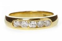 Lot 598 - EIGHTEEN CARAT GOLD DIAMOND SET BAND with five...