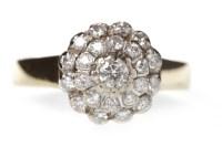 Lot 635 - EIGHTEEN CARAT GOLD DIAMOND CLUSTER RING the...