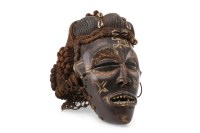 Lot 1014-EARLY 20TH CENTURY AFRICAN CARVED WOOD MASK with...