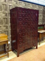 Lot 1027-20TH CENTURY CHINESE HARDWOOD MEDICINE CABINET...