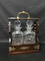 Lot 60 - TWO BOTTLE TANTALUS wooden tantalus with two...