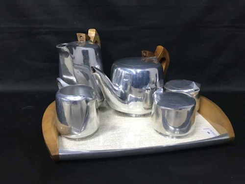 Lot 66 - PICQUOT WARE TEA AND COFFEE SERVICE on a...