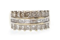 Lot 606-DIAMOND DRESS RING with a central row of channel...