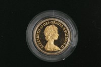 Lot 523-GOLD PROOF SOVEREIGN DATED 1980 in capsule, in...