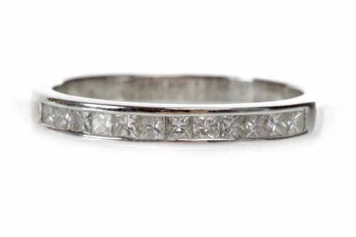 Lot 29-DIAMOND HALF ETERNITY RING with channel set...