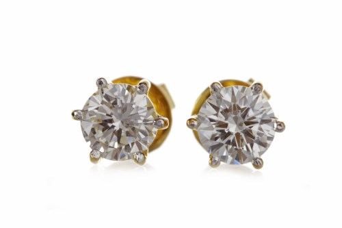 Lot 37-PAIR OF DIAMOND STUD EARRINGS each set with a...
