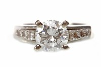 Lot 44-DIAMOND SOLITAIRE RING set with a four claw...