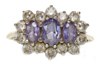 Lot 56-GEM SET RING set with a central row of oval blue...