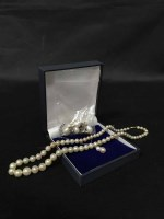 Lot 2-NINE CARAT WHITE GOLD CHAIN WITH PEARL PENDANT...