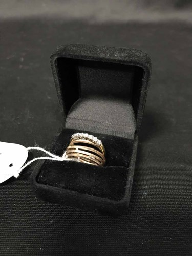 Lot 5-EIGHTEEN CARAT GOLD RING WITH SEVEN DIAMONDS...