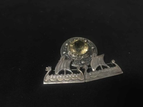 Lot 36-TWO SILVER VIKING LONG BOAT BROOCHES along with a ...