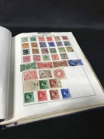 Lot 47-ALBUM OF U.K. AND WORLD STAMPS