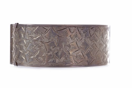 Lot 231-VICTORIAN STYLE SILVER BANGLE of oval form, the...