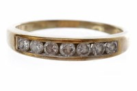 Lot 255-DIAMOND HALF ETERNITY RING with channel set round ...