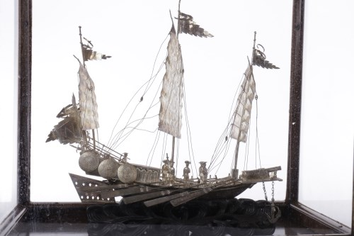 Lot 1002-CHINESE EXPORT SILVER JUNK with display case,...
