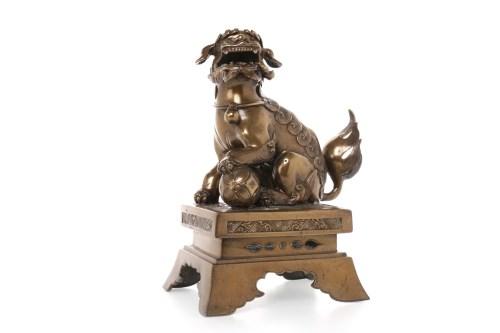Lot 1046-CHINESE BRONZE FOE DOG on a rectangular plinth...