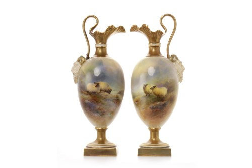 Lot 1223-PAIR OF ROYAL WORCESTER EWERS both of footed...