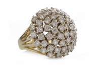 Lot 521-NINE CARAT GOLD WHITE GEM SET RING the bombe...