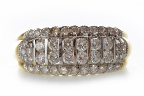 Lot 526-DIAMOND DRESS RING with two central rows of round ...